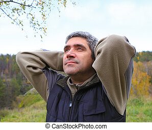 man outdoors against the sky