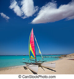 Catamaran sailboat in Illetes beach of Formentera at...