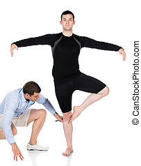 Adult male dancer wearing a black shirt and pants and ballet...