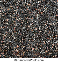 Gravel covered path fragment as an abstract background