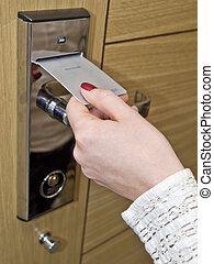 Hotel door key card - Hotel door - womans hand inserting key...