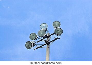 Stadium floodlights on blue sky