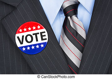 Voting politician - A politician wearing his lapel voting...