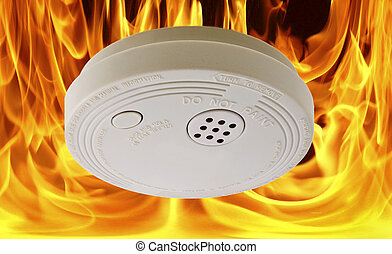 Flaming Fire Alarm - Concept photo of fire alarm safety...