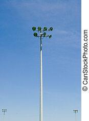 Stadium floodlight tower on blue sky