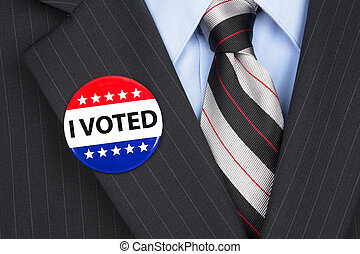 I voted pin on lapel - A male voter in his business suit...