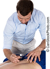 Physiotherapist doing accupuncture
