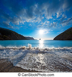 Ibiza Cala Benirras sunset beach in san Juan at Balearic...