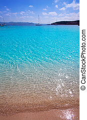 Ibiza Cala Bassa beach with turquoise Mediterranean sea at...