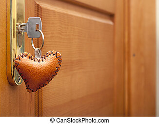 wooden door lock with a heart shaped key-ring