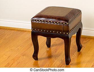 Leather footstool on traditional Oak floors - Horizontal...