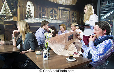 cafe life - A group of people having a drink in a cafe