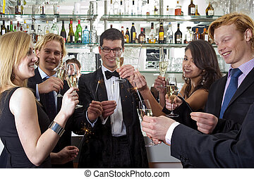 Toasting on a new Years Eve Party - several people toasting...