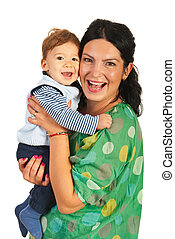 Happy mom and baby boy laughing together isolated on white...