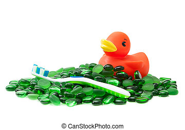 bathtime - A rubber duckie and toothbrush on a sea of green...