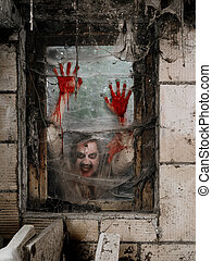 Hungry zombie at the window - Photo of a hungry zombie...