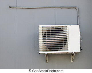 Air conditioning condensor and pipe line on the wall