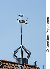 Roof top with decorated weather vane - Rooftop with...
