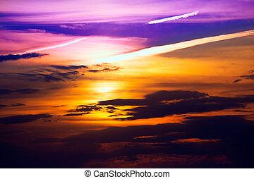 Ibiza sunset from Cala Conta Comte orange sky clouds
