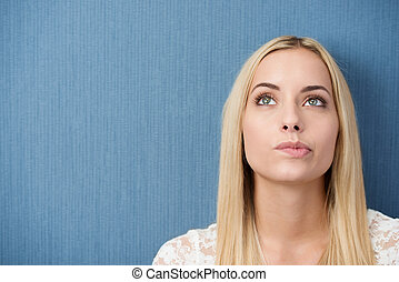 Thoughtful young woman biting her lip - Thoughtful young...