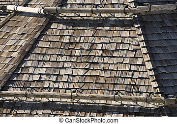 Ancient Roof with Snow Guards - Detail of old wooden roof...