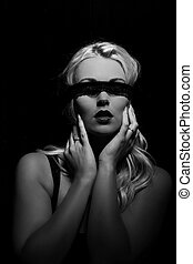 Blond woman wearing blindfold - Attractive blond woman...