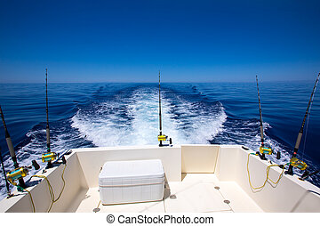 Fishing boat stern deck with trolling fishing rods and reels...