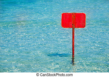 turquoise tropical sea with red sign blank copyspace