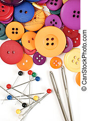 Sewing kit and colorful buttons - Needles and pins with...