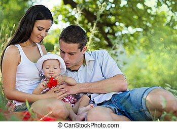 Happy family - Happy young family spending time together in...