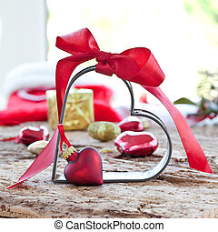 Christmas decorations and a heart-shaped cookie cutter with...