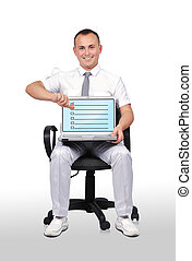 laptop with checklist - businessman sitting in chair and...