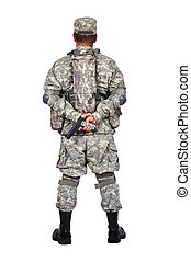 US soldier with gun standing back