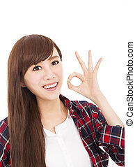 smiling young woman with ok gesture