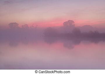 red  misty sunrise over calm lake, Drenthe, Netherlands