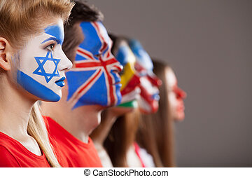 Several faces painted. Different countries face art in...