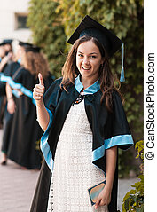 University graduate with a diploma
