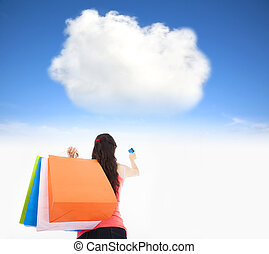 young woman shopping on the internet cloud concept