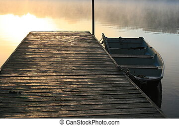 water   dock - boat tide to a  dock   in  morning  sunrise