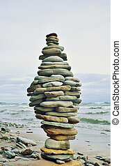 Steadfast - Stack of stones on the sea beach
