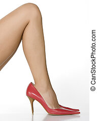 Beautiful legs in red big shoes isolated on white background