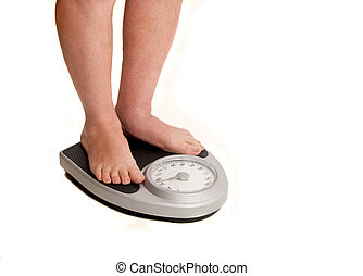 Feet On Weight Scale - bare feet and legs on bathroom scale