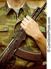 Soldier with AK-47 assault rifle