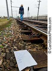 woman walks in suicide intent on a track - a young woman...