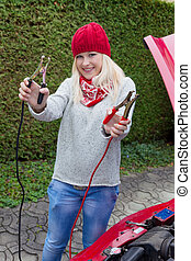 start by using jumper cables - a young woman takes off her...