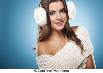 Portrait of beauty woman wearing white earmuffs