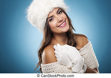 Portrait of beautiful and smiling winter woman