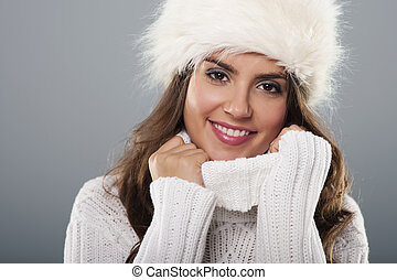 Beautiful young woman wearing big fur cap