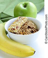 granola bar, green apple and banana - healthy eating