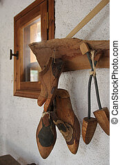 shoe workshop - shoe lasts hanging on the wall in the...